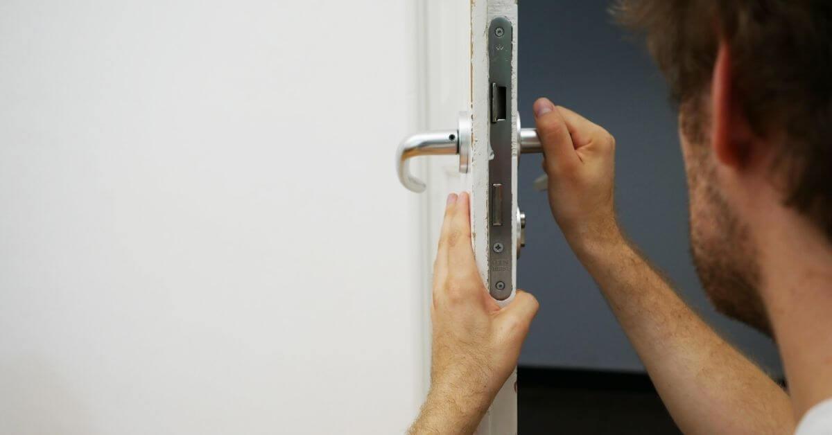 locksmith working on a white door
